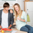 Young couple having fun in the kitchen — Stock Photo