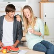 Young couple having fun in the kitchen — Stock Photo #26248533