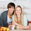 Smiling couple in the kitchen — Stock Photo #26248541