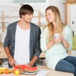 Young couple preparing something to eat — Stock Photo