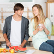 Young couple preparing something to eat — Stock Photo #26248891