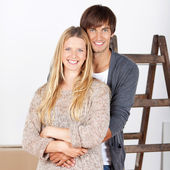 Happy young couple renovating their home — Stock Photo