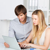 Man and woman working in the office — Stock Photo