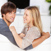Amorous couple relaxing at home — Stock Photo