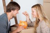 Couple saving money — Stock Photo