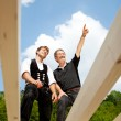 Two carpenters discussing the work on the roof — Stock Photo