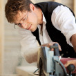 Carpenter using a circular saw — Stock Photo