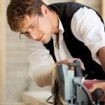 Carpenter using a circular saw — Stock Photo #26254839