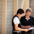 Master carpenter and his assistant — Stock Photo
