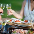 At dining table toasting with wine — Stockfoto