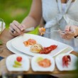 Woman having nice dinner outdoors — Foto Stock