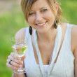 Cheerful woman holding a glass of wine — Stock Photo
