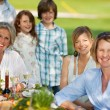 Happy family having dinner in the garden — Stock Photo