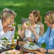 Family Toasting White Wine At Dining Table — Stock Photo