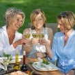 Happy women saying cheers with white wine — Stock Photo