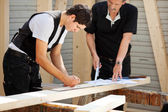 Two carpenters at work — Stock Photo