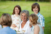 Happy Siblings With Family In Lawn — Stock Photo