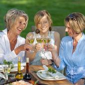 Happy women saying cheers with white wine — Stock Photo