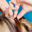 Stock Photo: Hairdressers Hands Pinning Up Clients Hair
