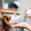 Hairdressers Hands Using Hairspray On Clients Hair — Stock Photo