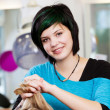 Portrait of a young woman working in salon — Stok fotoğraf