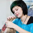 Young stylist with tattoo at work — Stock Photo