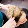 Hair Dresser Combing Clients Hair In Salon — Stock Photo