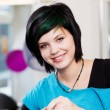 Smiling young hairdresser — Stock Photo