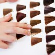 Client's Hand Choosing Color From Hair Samples — Stock Photo