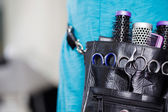 Female Hairdresser With Leather Tool Bag In Salon — Stock Photo