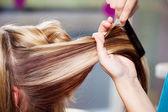 Hair Dresser Combing Clients Hair In Salon — Stock Photo