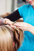 Young hairdresser pinning up hair — Stock Photo