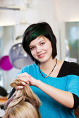 Portrait of a young woman working in salon — Stock Photo