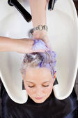 Woman Getting Hair Washed In Hair Salon — Stock Photo
