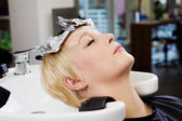 Client Resting Head On Washbasin In Salon — Stock Photo