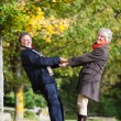 Stock Photo: Playful senior couple
