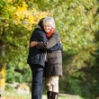 A senior couple embracing each other in love — Stock Photo