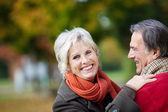 A happy senior couple enjoying a moment of love — Stock Photo