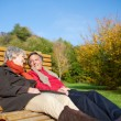 Senior couple relaxing in the autumn sun — Stock Photo