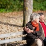 Senior couple in park — Stock Photo #26290761
