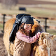 Stock Photo: Young horse-rider girl with equipment