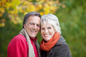 Joyful attractive senior couple in nature — Stock Photo