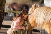Young girl demonstrating affection for her horse — Stock Photo