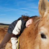 Girl demonstrating affection foe her horse — Stock Photo
