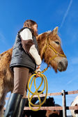 Low angle view of a girl and her horse — Stock Photo