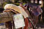 Horse saddle and a map — Stock Photo