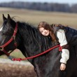 Stock Photo: Playful young girl riding on horse