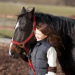 Stock Photo: Proud young girl leading her horse