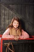 Pretty young girl in the stable — Stock Photo