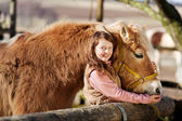 Happy girl poses next to her horse — Stock Photo
